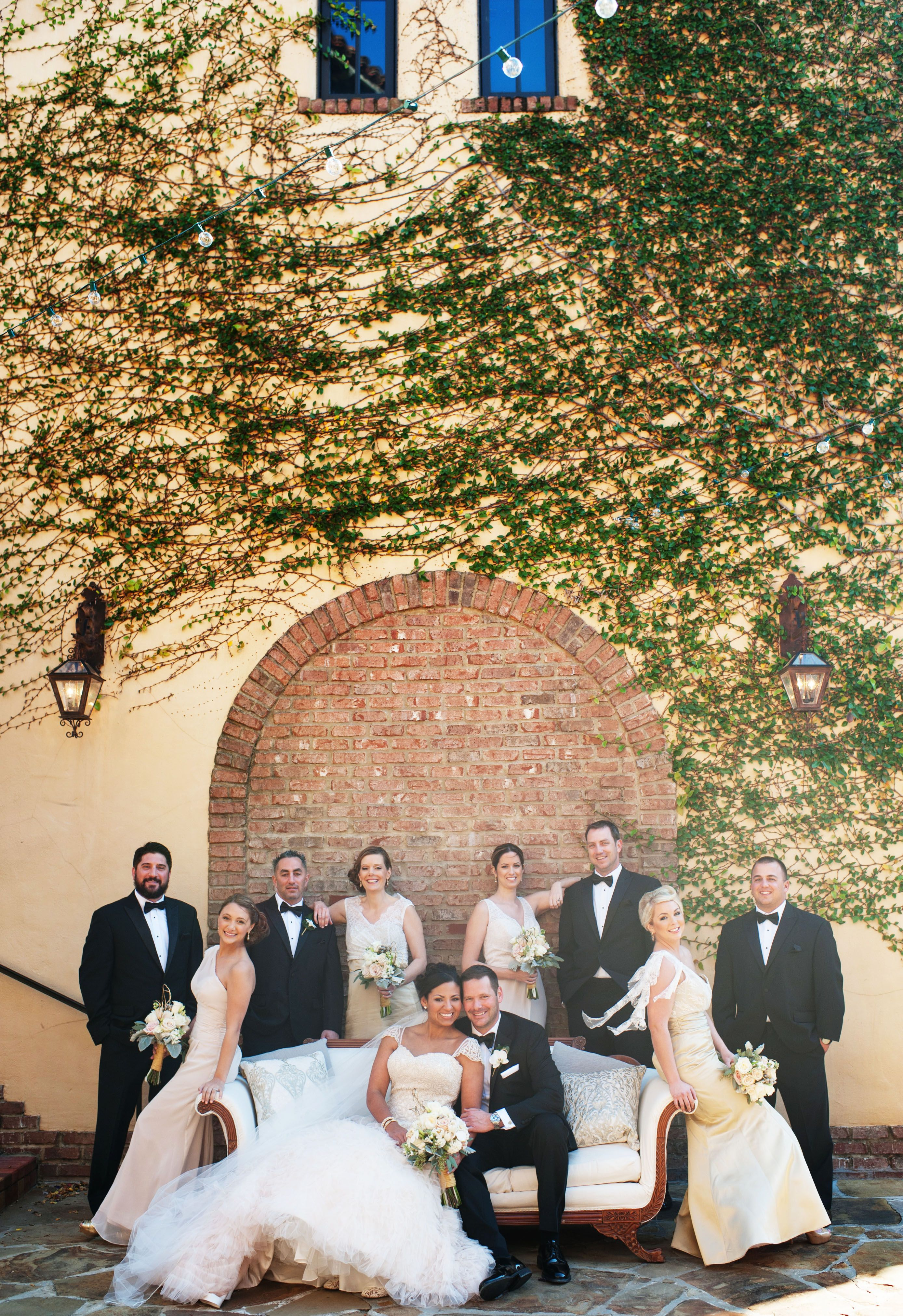 Perfect Tuscan backdrop for this lovely wedding party || Bella Collina Weddings