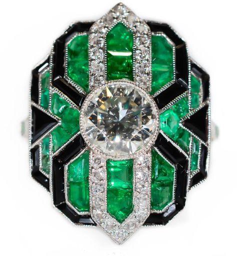 Estate Platinum Diamond Emerald and Onyx Ring 1.28CT Round Center Art Deco by BellmansOnlineStore on Etsy https://www.etsy.com/listing/225581018/estate-platinum-diamond-emerald-and-onyx