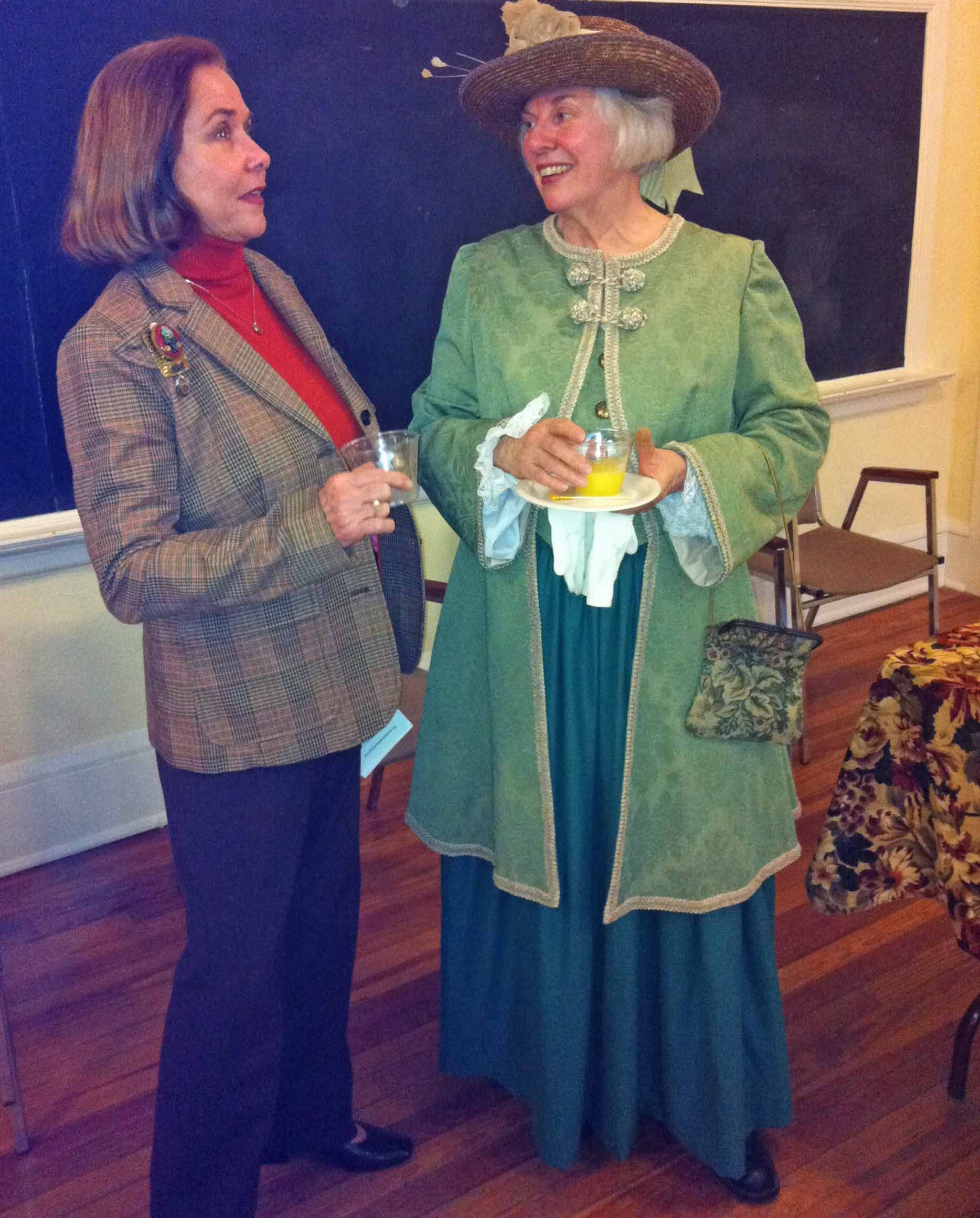 Former Sarasota Sister Cities President Hope Byrnes reacts to stories by Janet Knowles of Historic Heritage Village in Hamilton, Ontario at Spanish Point