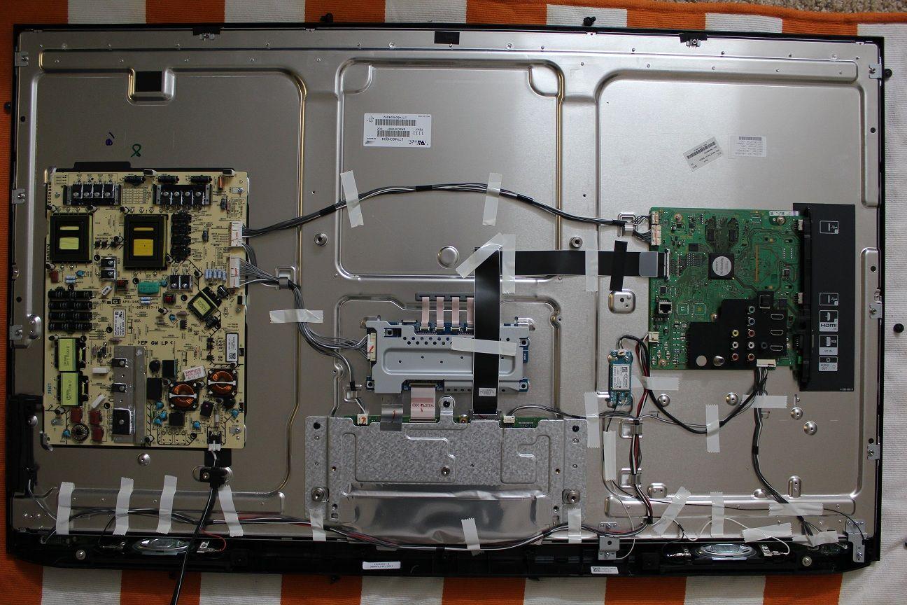Rear view of LCD TV internal components, t-con board, power board, inverter  boards, AV board., ribbon cables. www.duotechelectronics.co.uk