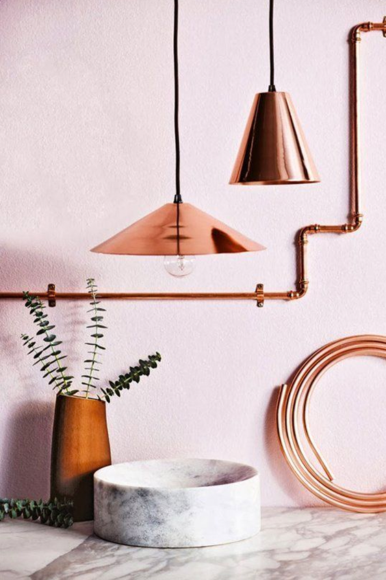 Copper details marble rose pink walls in the kitchen