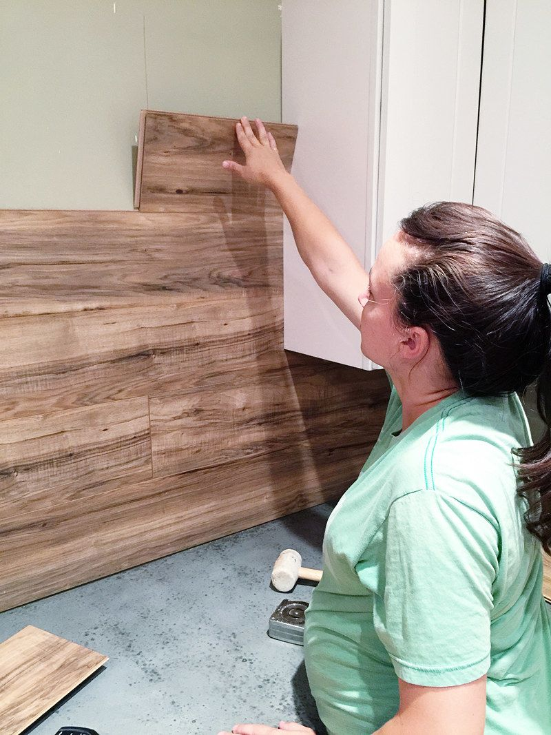 Photo of Tack laminate floorboards to the wall to create a farmhouse-style backsplash.