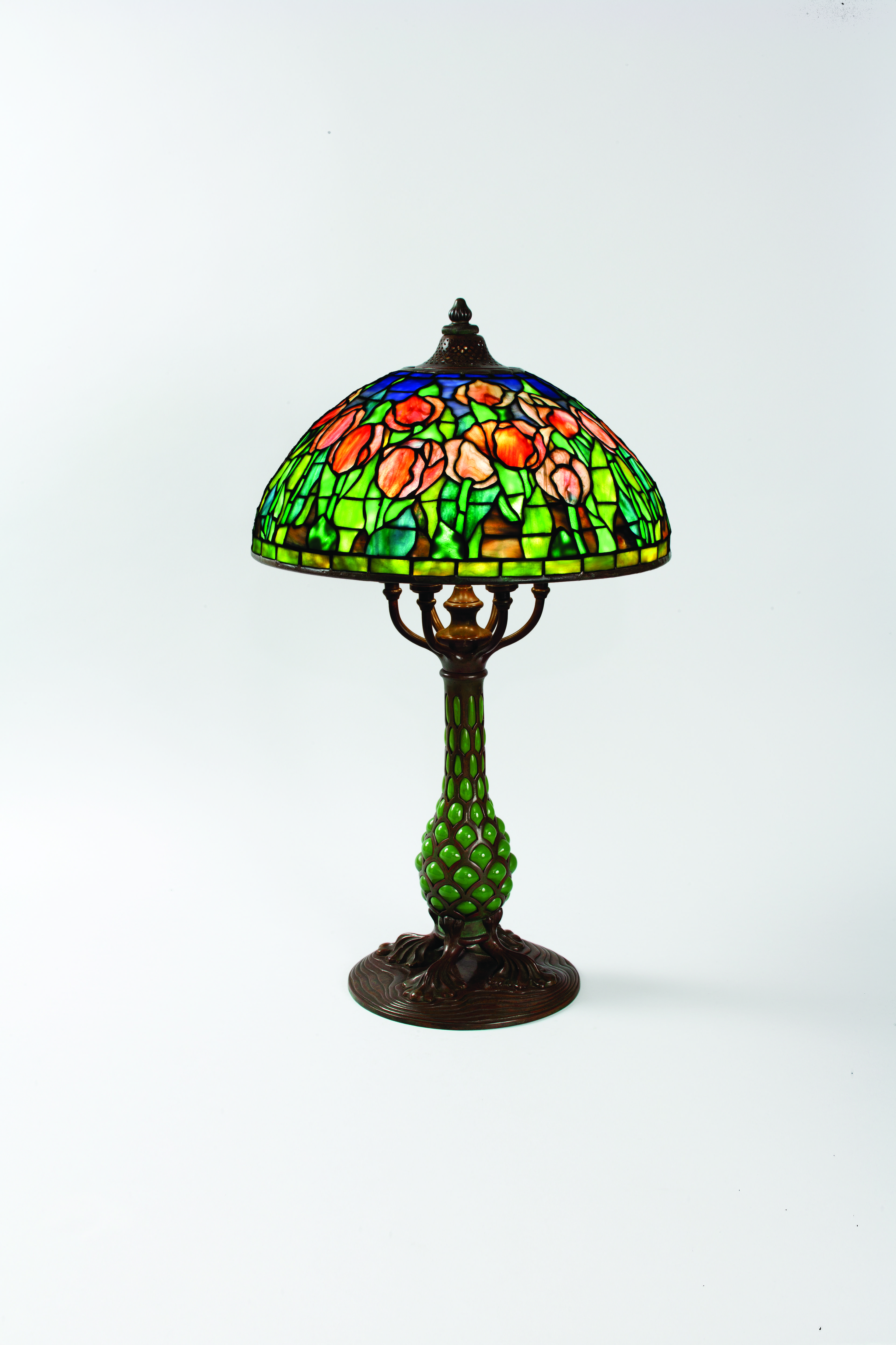Tiffany Studios Tulip Table Lamp With Pink And Red Flowers On A Blue Green Ground Accented By Two Bands Of Gl At The Top