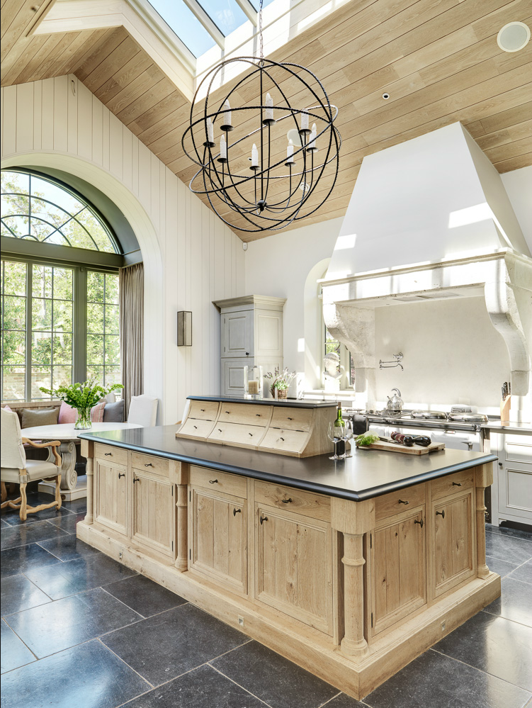 Bleached Oak + Beautiful Range Hood + grand windows