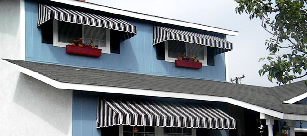 Window Awning Lowered Across Three Double Hung Windows At House Front The Striped Fabric Colors Were Chosen To Match Shutters And Siding