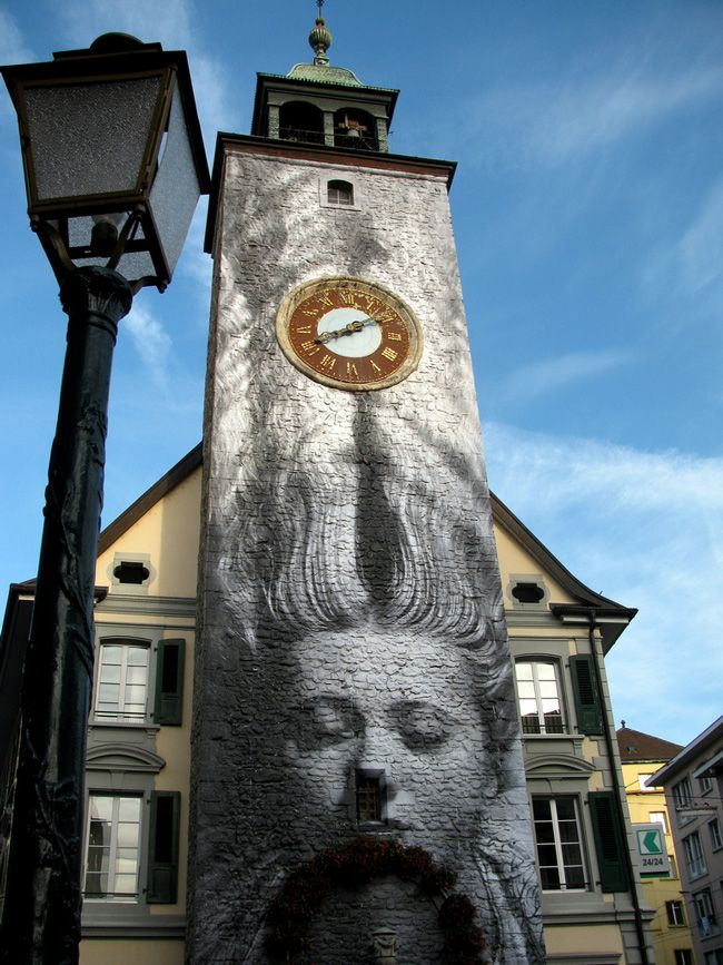 J.R. - Unframed project, #streetart in Vevey, Switzerland for Images Festival. Unframed project uses source images from other photographers and pasting them out of context. Here J.R. uses a Man Ray's photo.