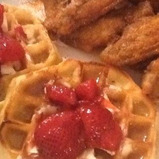LIFETIME MOVIE DAY CHICKEN & WAFFLES SAVORY FRIED WINGS WITH EGGO THICK & FLUFFY WAFFLES (BLUEBERRY WAFFLES ARE GREAT TOO). TOPPED WITH BUTTER & REAL MAPLE SYRUP AND SLICED STRAWBERRIES :-)