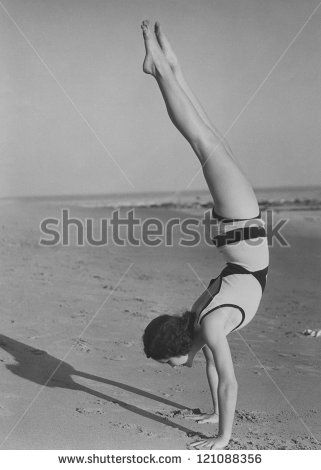Handstand at the beach - stock photo