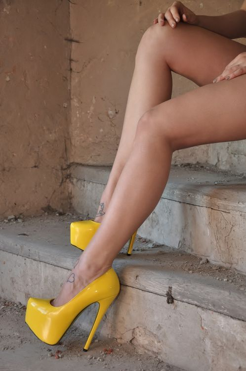 bf759e2be71 Sky high yellow platform heels at the bottom of long sexy legs. Try ...