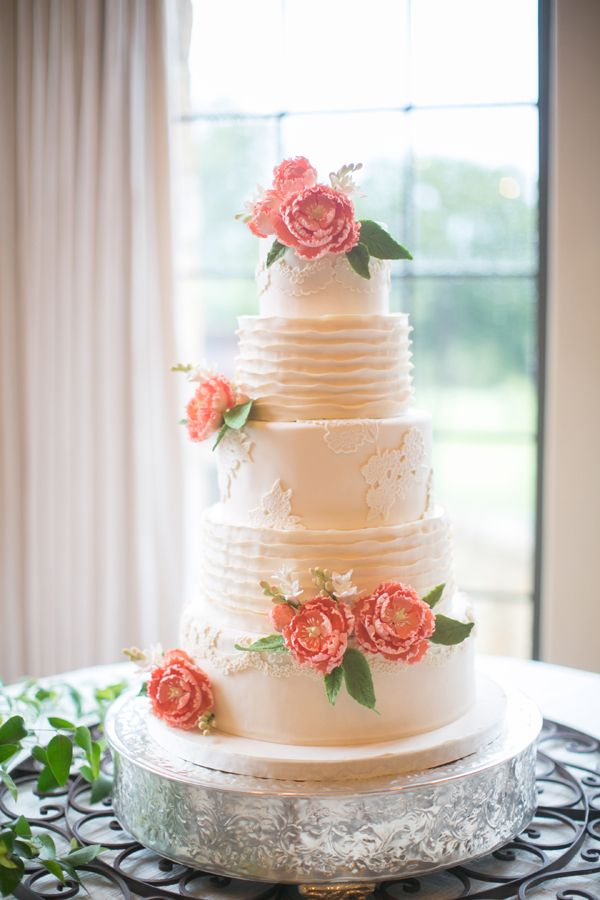 classic tiered buttercream wedding cake with peach flowers