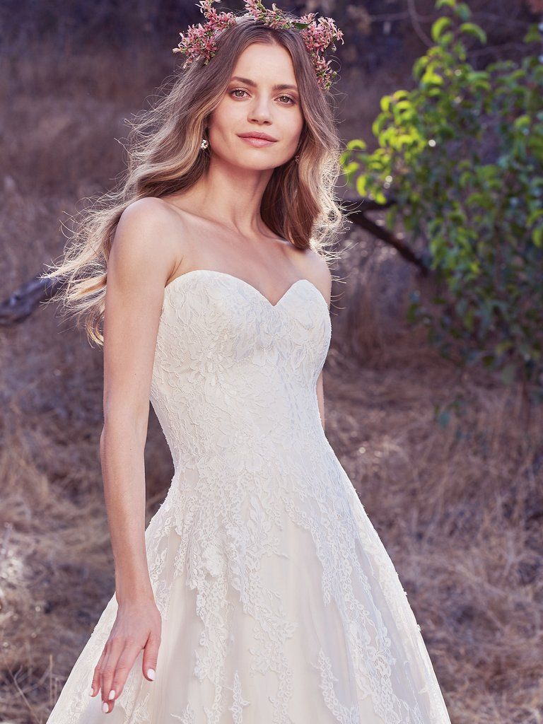 Timeless wedding dresses  OLEA  Cascades of breathtaking lace motifs elevate this timeless A