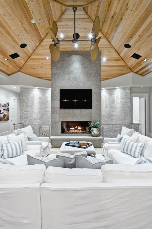 Source: Beach Chic Design Gorgeous Living Room With Wood Paneled Vaulted  Ceiling, Modern Stone Fireplace, U Shaped White Slipcover Sectional Sofa,  ...