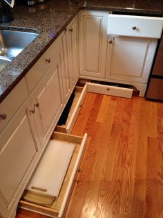 Utilize the space beneath kitchen/bathroom cabinets by incorporating toe-kick  drawers. Hidden