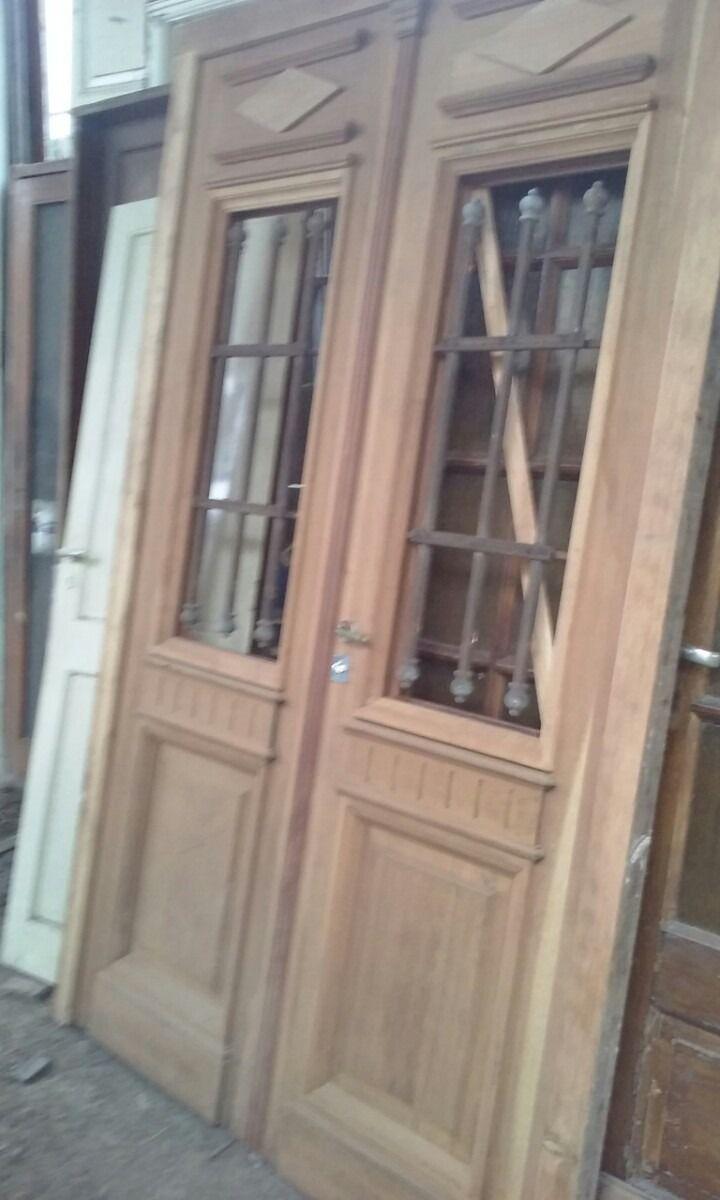 ventana de madera 2 hojas con rejas forjadas