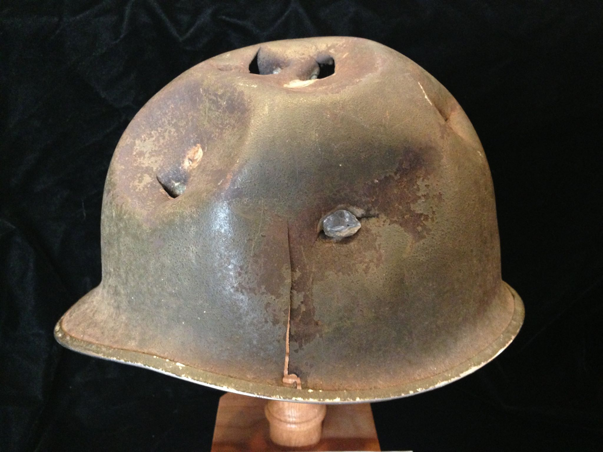 A severely battle damaged M-2 helmet recovered in Sainte