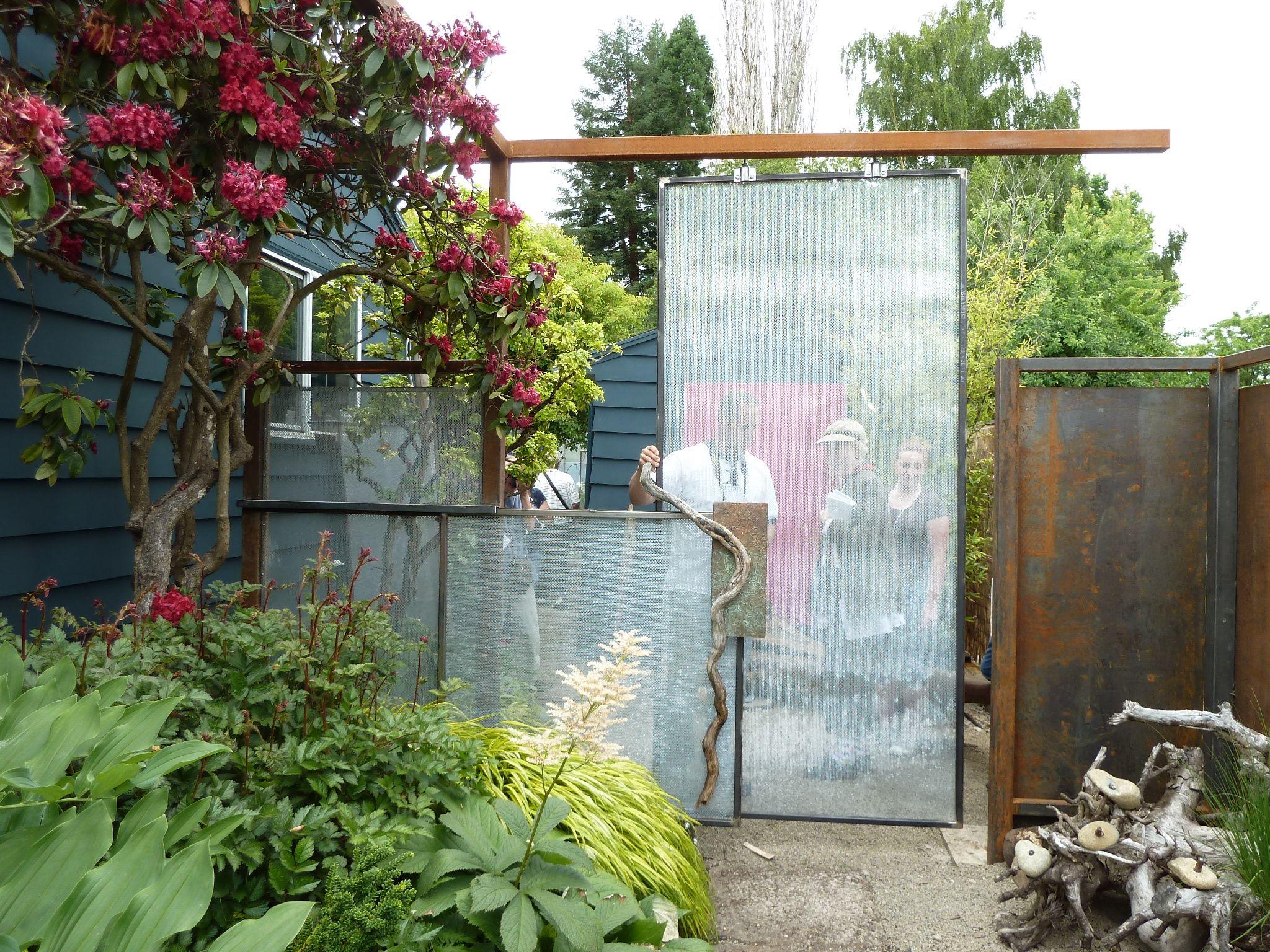 Sliding glass shower doors repurposed to create rooms for Sliding glass doors garden
