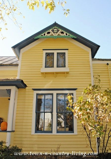 Clapboard Farmhouse She S Finally Painted Town Country Living Yellow House Exterior House Exterior Exterior Paint Colors For House