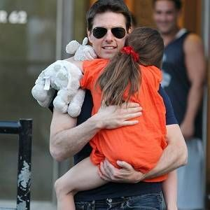 Tom Cruise went on holiday with his daughter Suri and gave her gifts in advance of her seventh birthday.