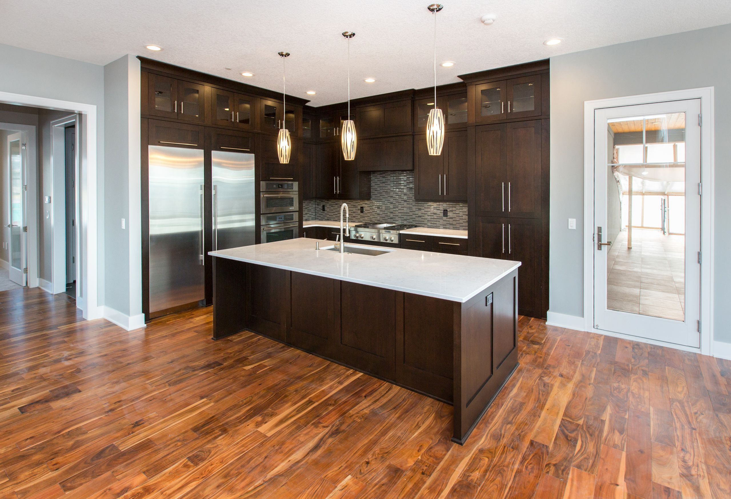 LOVE this modern look- dark kitchen cabinets, light ...
