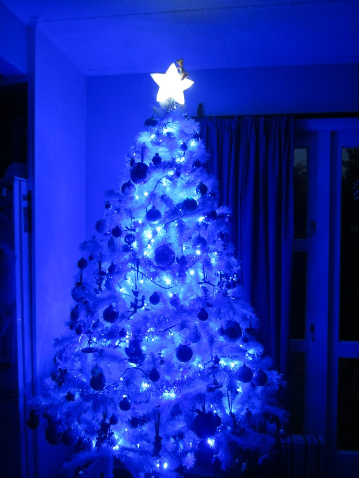 White christmas tree with blue christmas lights also a Over the top christmas tree decorations