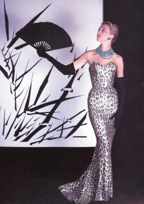 Marie-Thérèse in Balmain's famous sheath of embroidered pailettes in leopard spot design, 1953. Photo by Philippe Pottier.