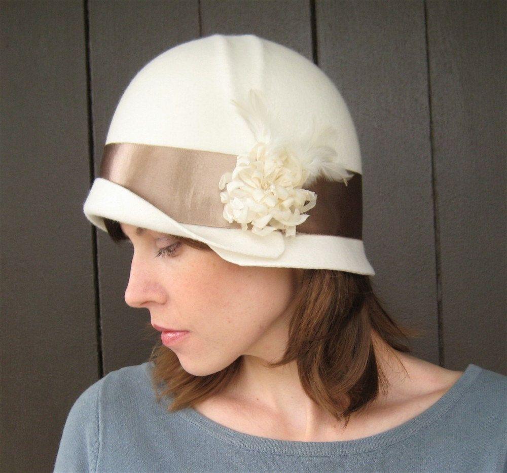 Bridal Cloche Hat, Ivory Felt, Satin Ribbon, Flower, Feathers, Handmade Millinery Wedding Hat. $195.00, via Etsy.