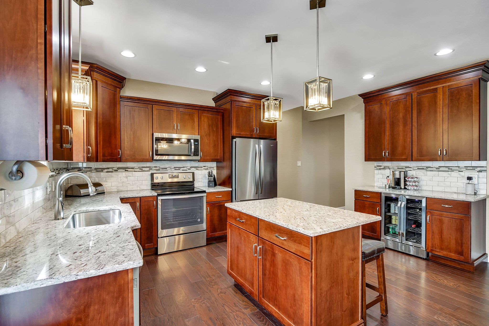 This Beautiful Kitchen Comes From Our Manchester Plan The Kitchen Includes Maple Cabinetry And A Kitchen Inspirations Beautiful Kitchens Custom Home Builders