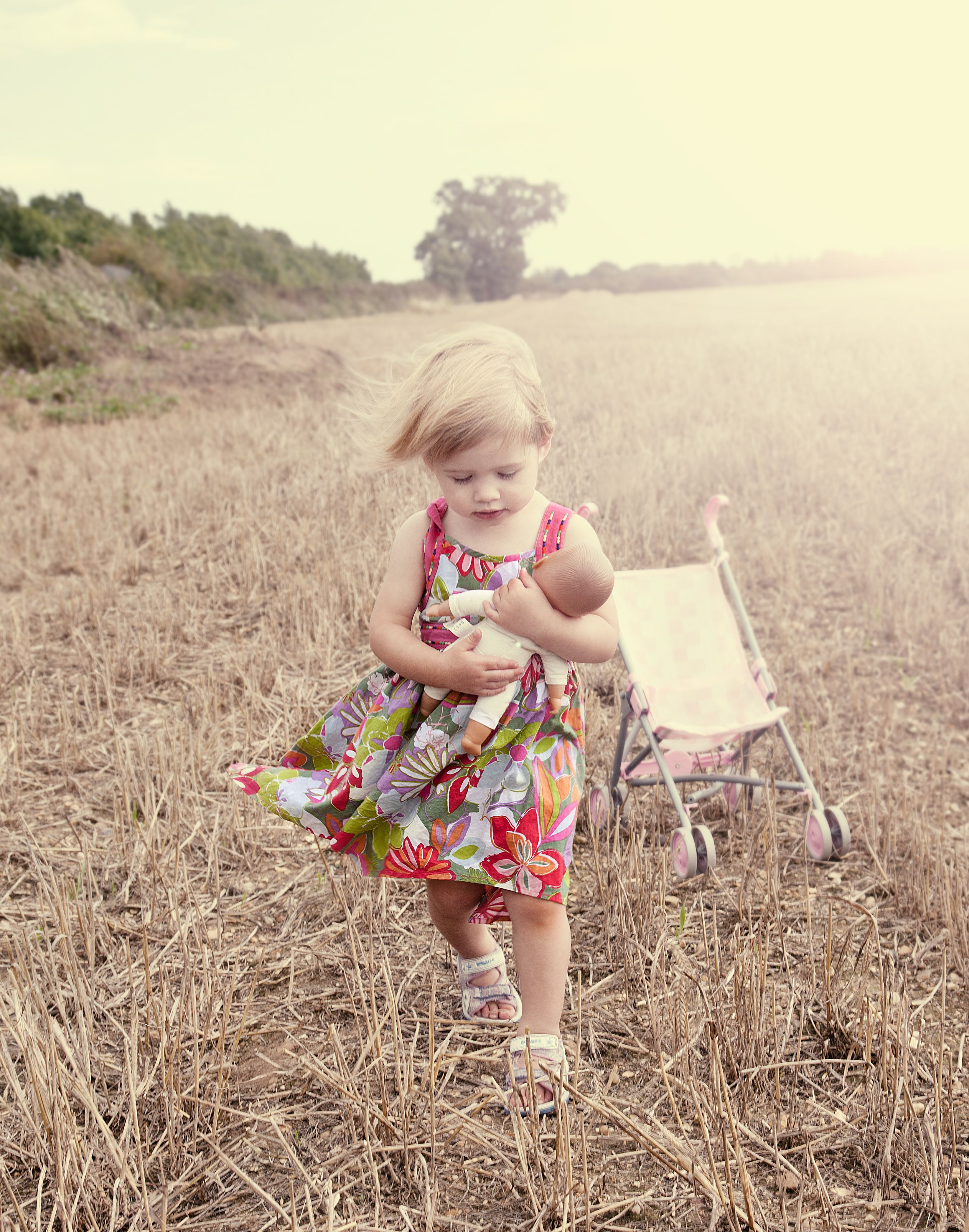 cute child / kid portrait I took of my niece playing with doll in a field near my home.