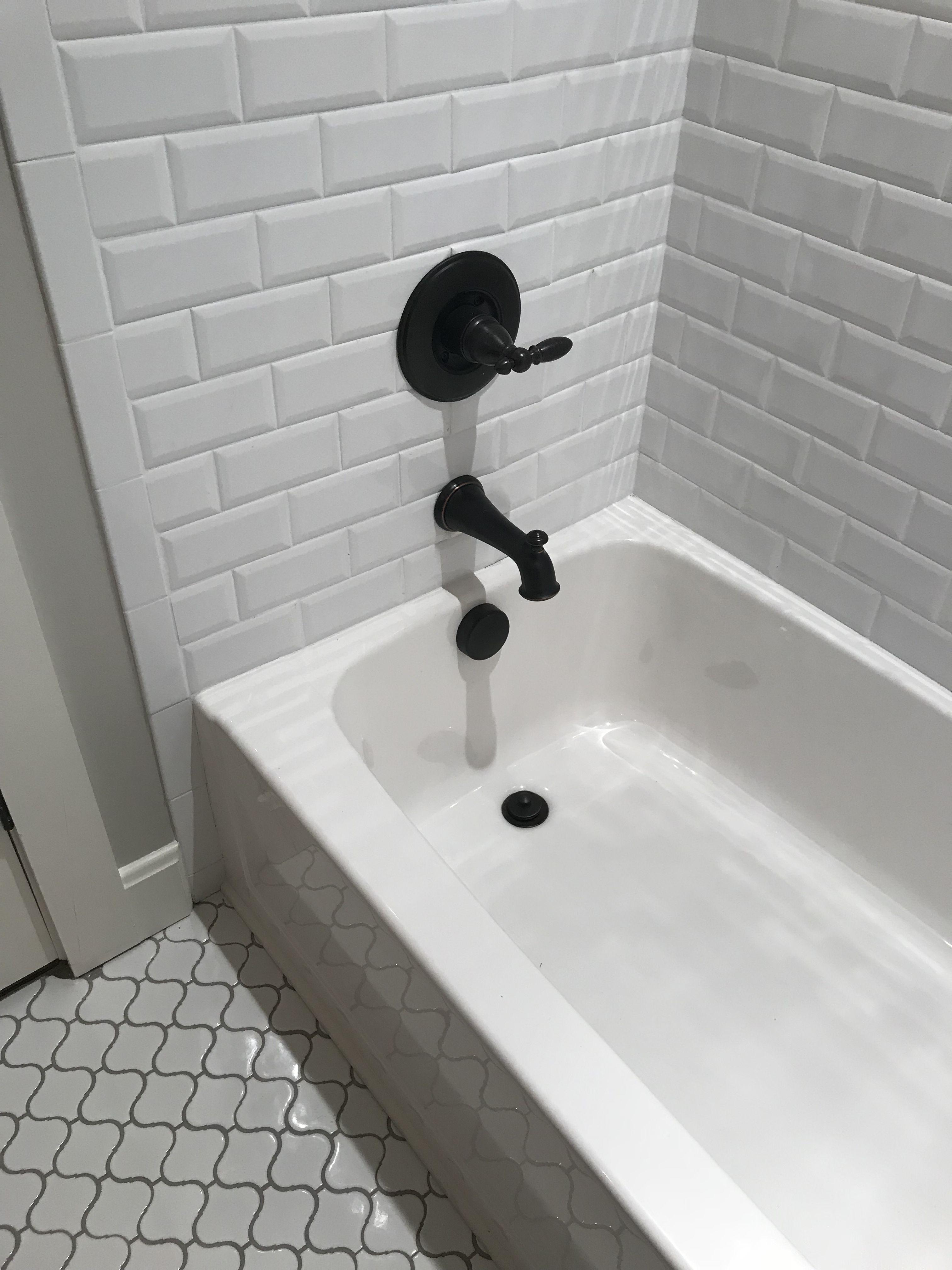 Beveled edge subway tile for the tub surround and quatrefoil white ...