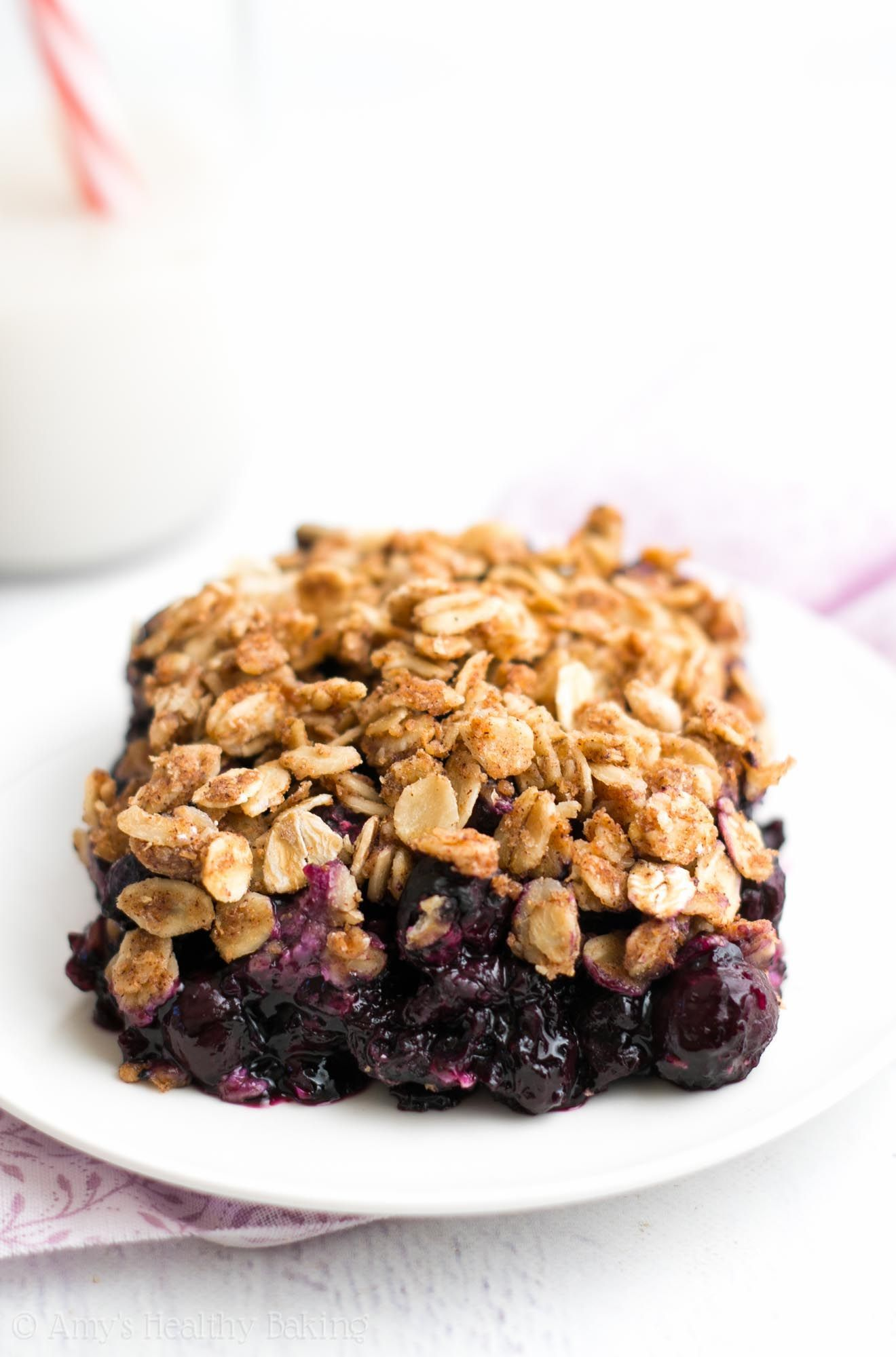 Ultimate Healthy Blueberry Crumble Crumble -- this easy dessert is healthy enough for breakfast! It has a full serving of fruit & just 127 calories!