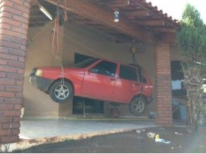 Man Hangs Car From Roof, Saves From Flood