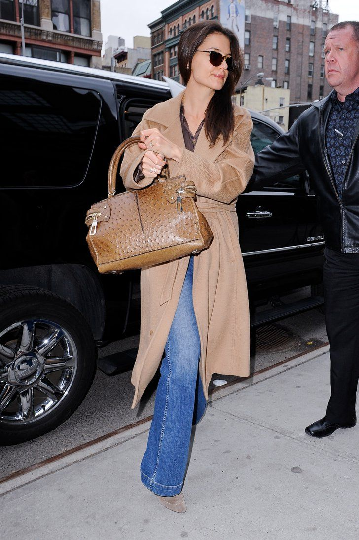 Working a prim camel coat and ostrich tote long before it was trendy. | Chic, Sporty, or Sexy: Why Katie Holmes Is a Denim Chameleon | POPSUGAR Fashion