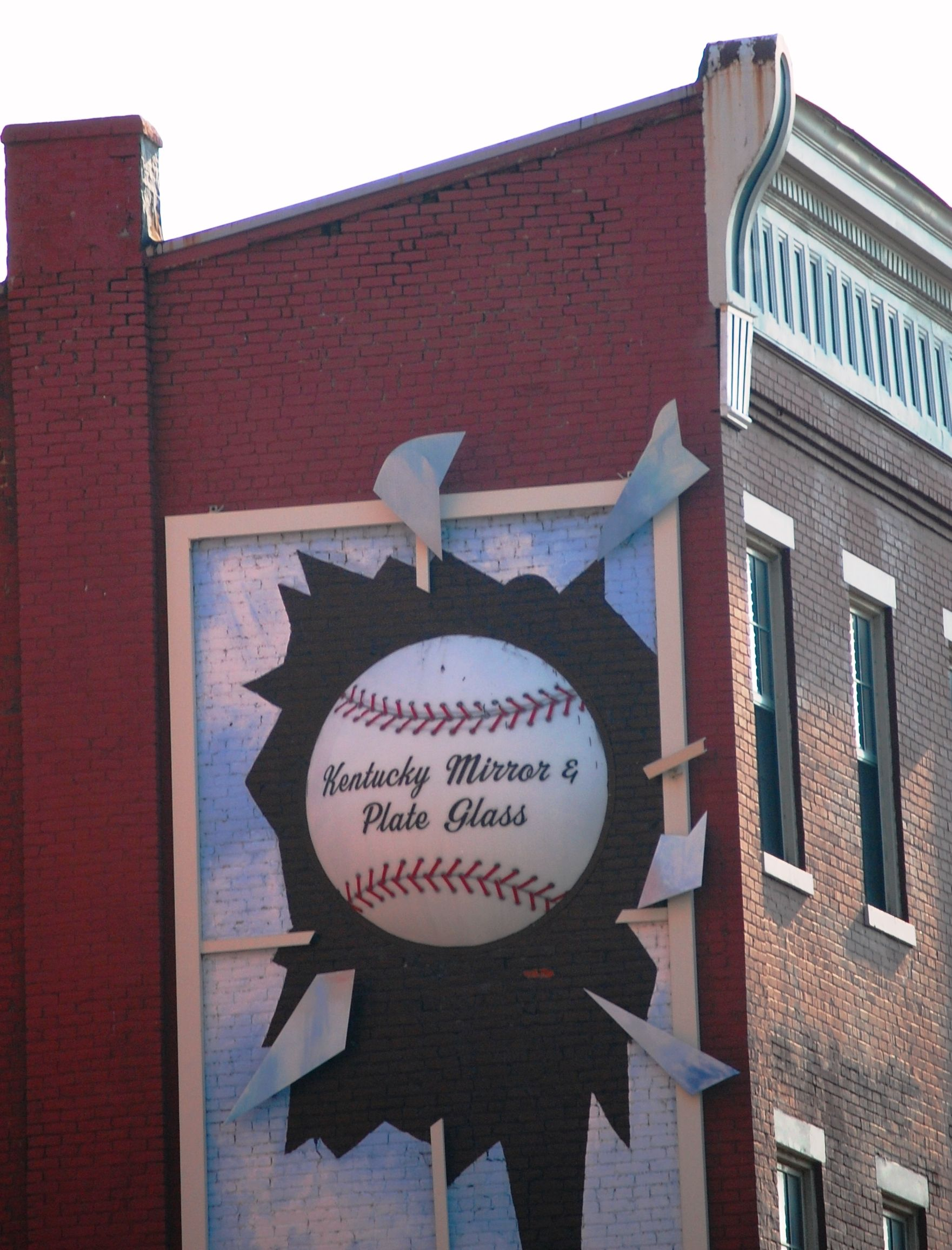 Giant baseball advertising a Mirror and Plate Glass