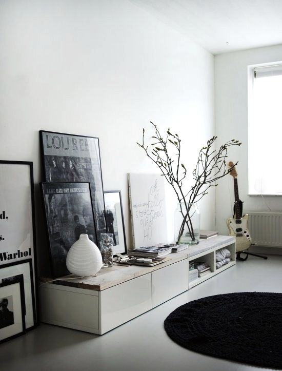 How to style cabinet or shelf with large frames, lamps, magazines and plants.