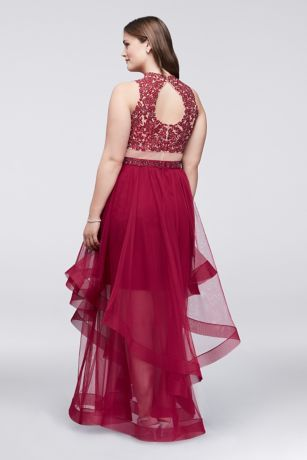 6d884ba4895 This dramatic plus size dress features a stunningly embroidered halter top  and a ruffled tulle skirt