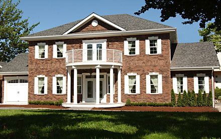 A Georgian Colonial Revival house usually has a portico and can have a  porch on top