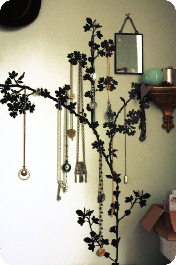 Trace and paint a flowering tree on the wall, then drill little hooks into the branches and hang up all necklaces.