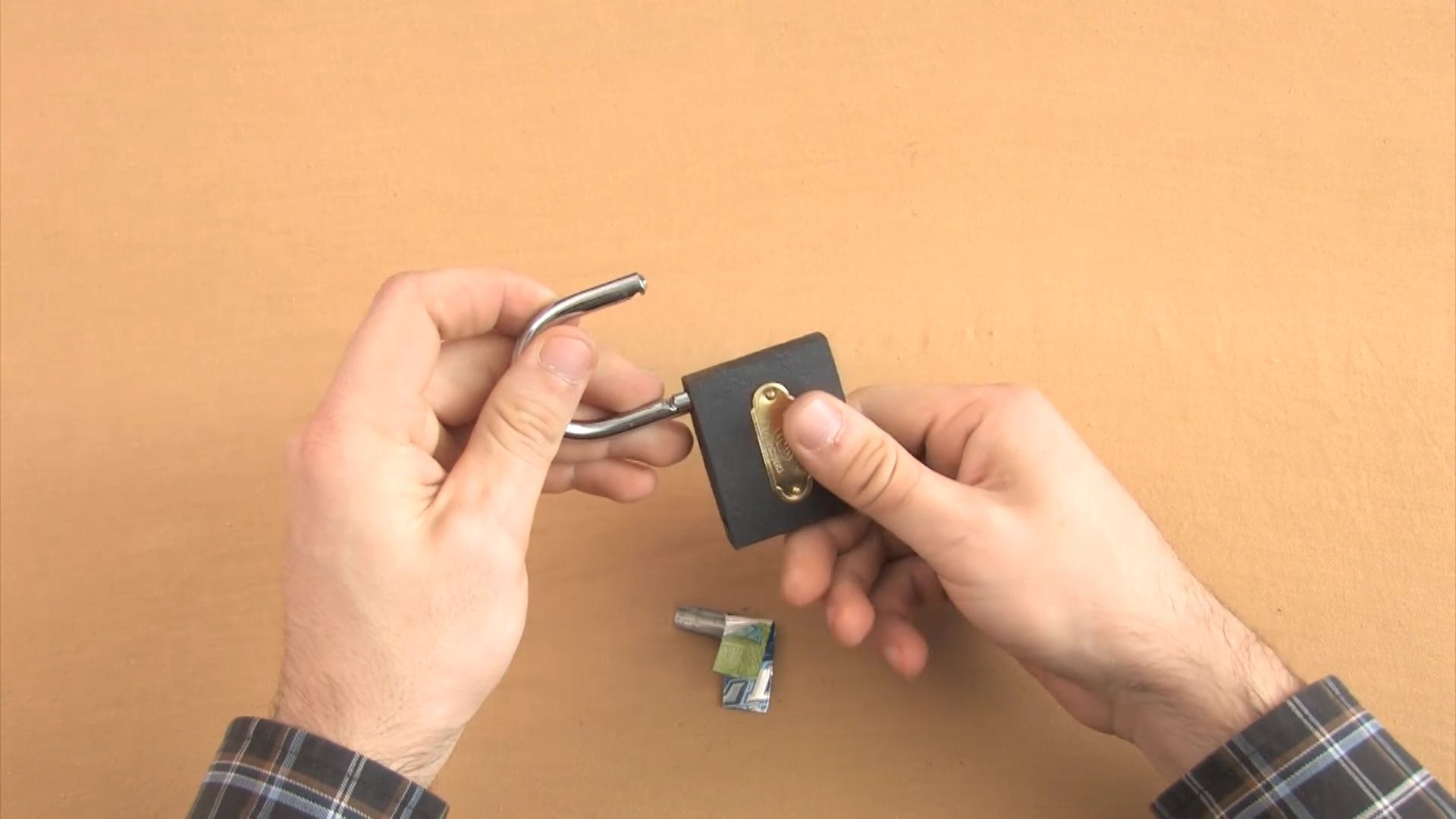 Have you lost the key to a padlock? You could call a locksmith or cut the shackle, but you may be able to quickly and easily open it with a shim, a thin piece of metal that you slide into the locking mechanism. You can buy shims from $2-20, or you can make them with metal you have laying around the house. Here's how to create and use a shim made from an aluminum can.