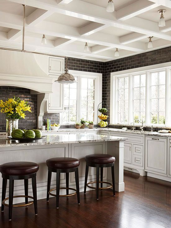 white kitchen, coffered ceiling, black brick pattern tile to ceiling
