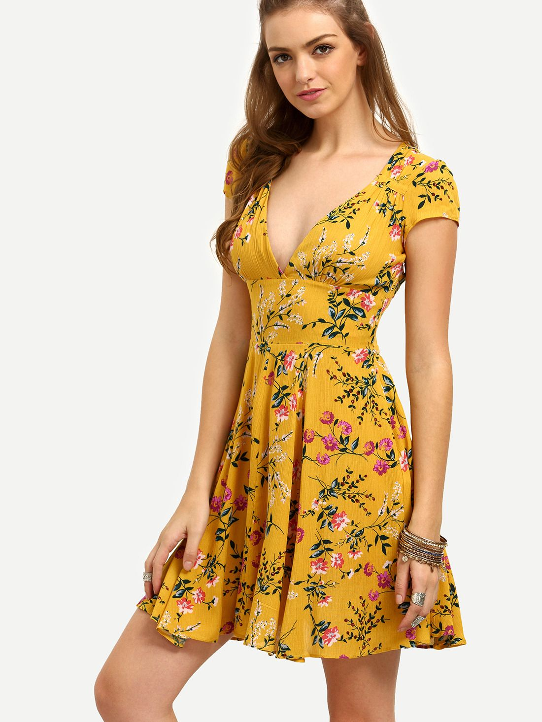 f5e18ddcb98d9 Shop Yellow Floral V Neck Cutout Dress online. SheIn offers Yellow Floral V  Neck Cutout Dress & more to fit your fashionable needs.