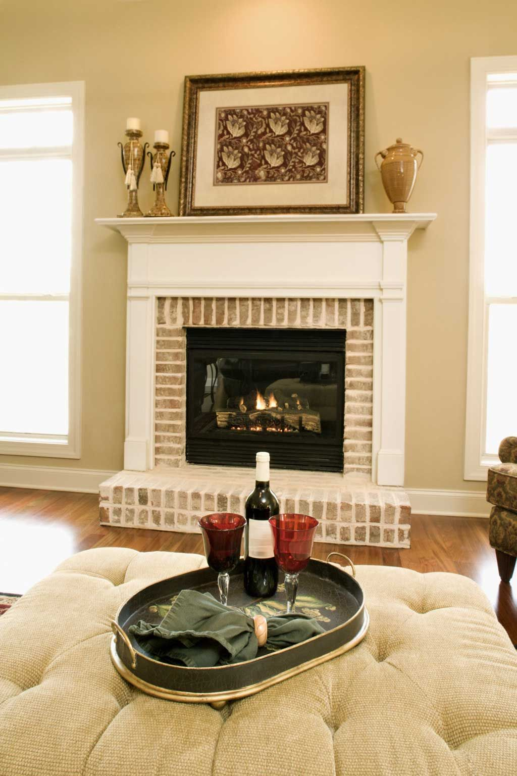 brick fireplace with white mantle