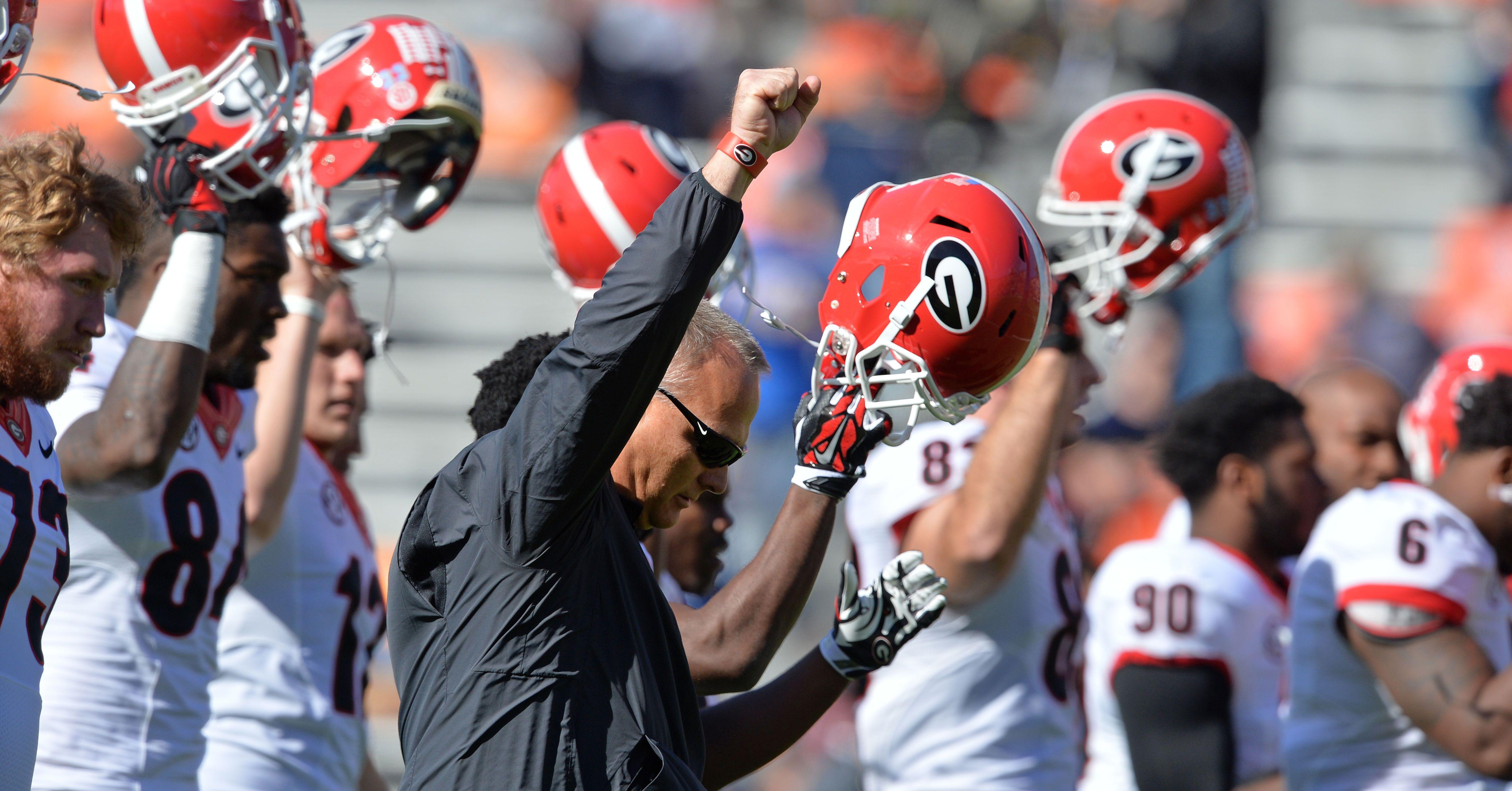 Photos Uga Earns A Crucial Win In Deep South S Oldest Rivalry Uga Rivalry Georgia Bulldogs