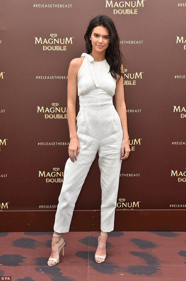 4a844274e3c A bit of all white  Kendall s pristine jumpsuit stood out against the brown  branded backdrop