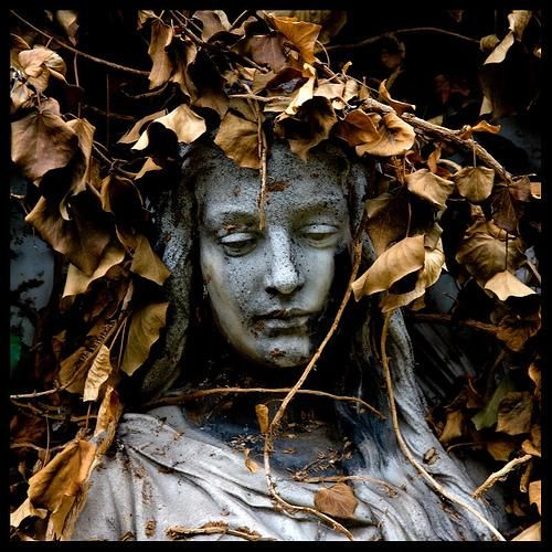 angel wreathed in leaves