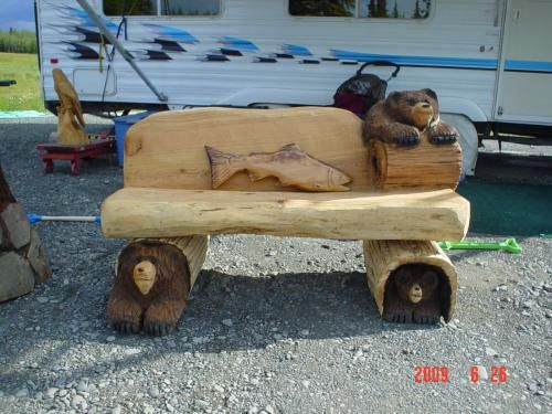 Tree wood carvings of dogs three bear bench chainsaw