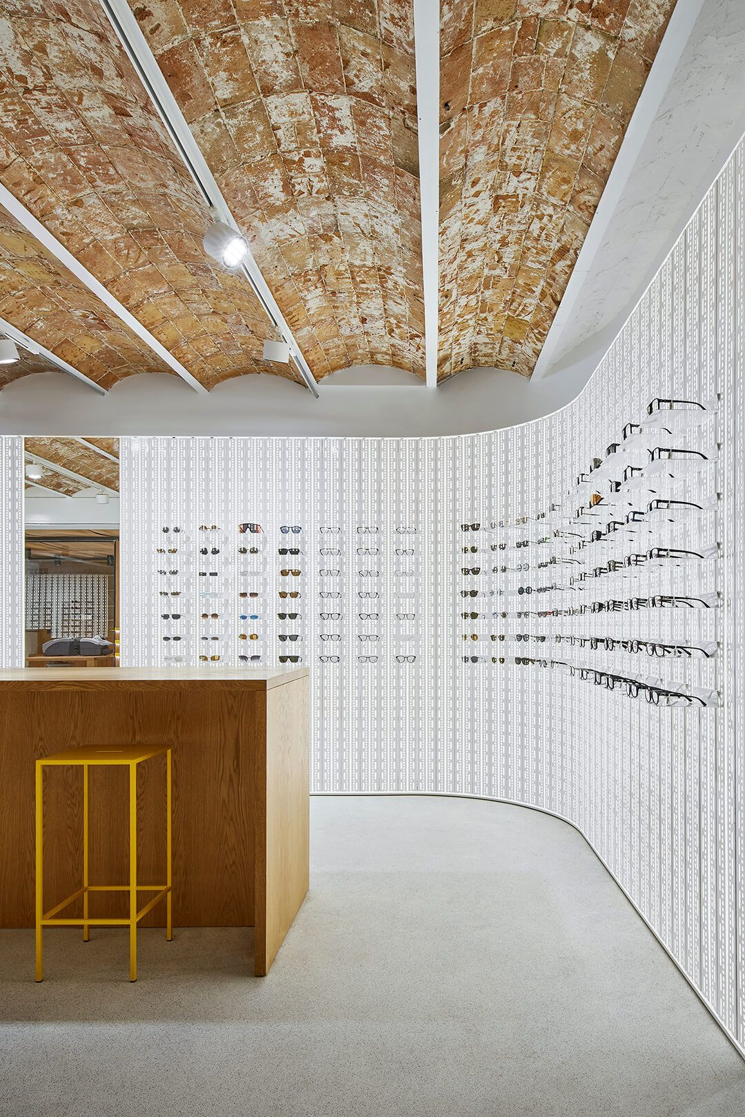 A German eyewear shop does localwithabrandtwist in Barcelona is part of Eyewear store design, Eyewear shop, Mykita, Jewelry store design, Eyewear store, Retail design - The new Mykita store in Barcelona shows that a mix of local identity and brand aesthetic can also convey a grounded retail narrative