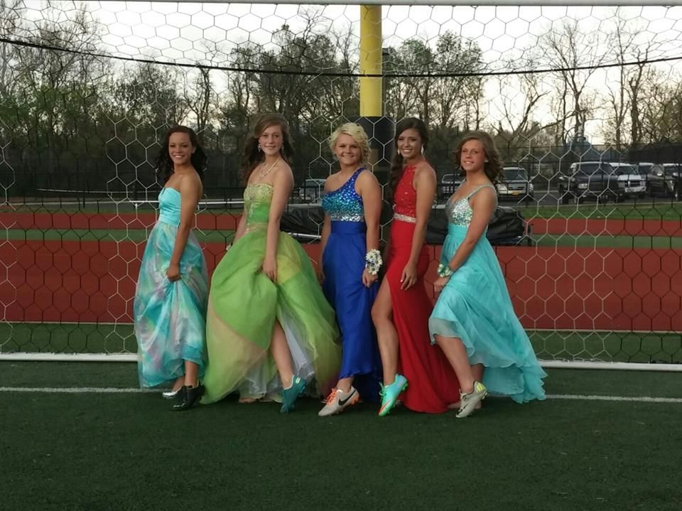 Soccer girls at prom with cleats on