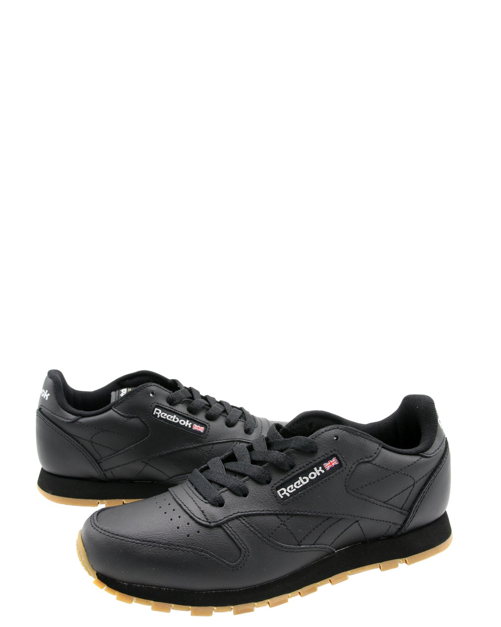 47193fbc0 Leather upper in black and gum. - Lace-up design. - Logo on side. - Lightly  padded insole. - Durable rubber gum outsole for grip and traction.