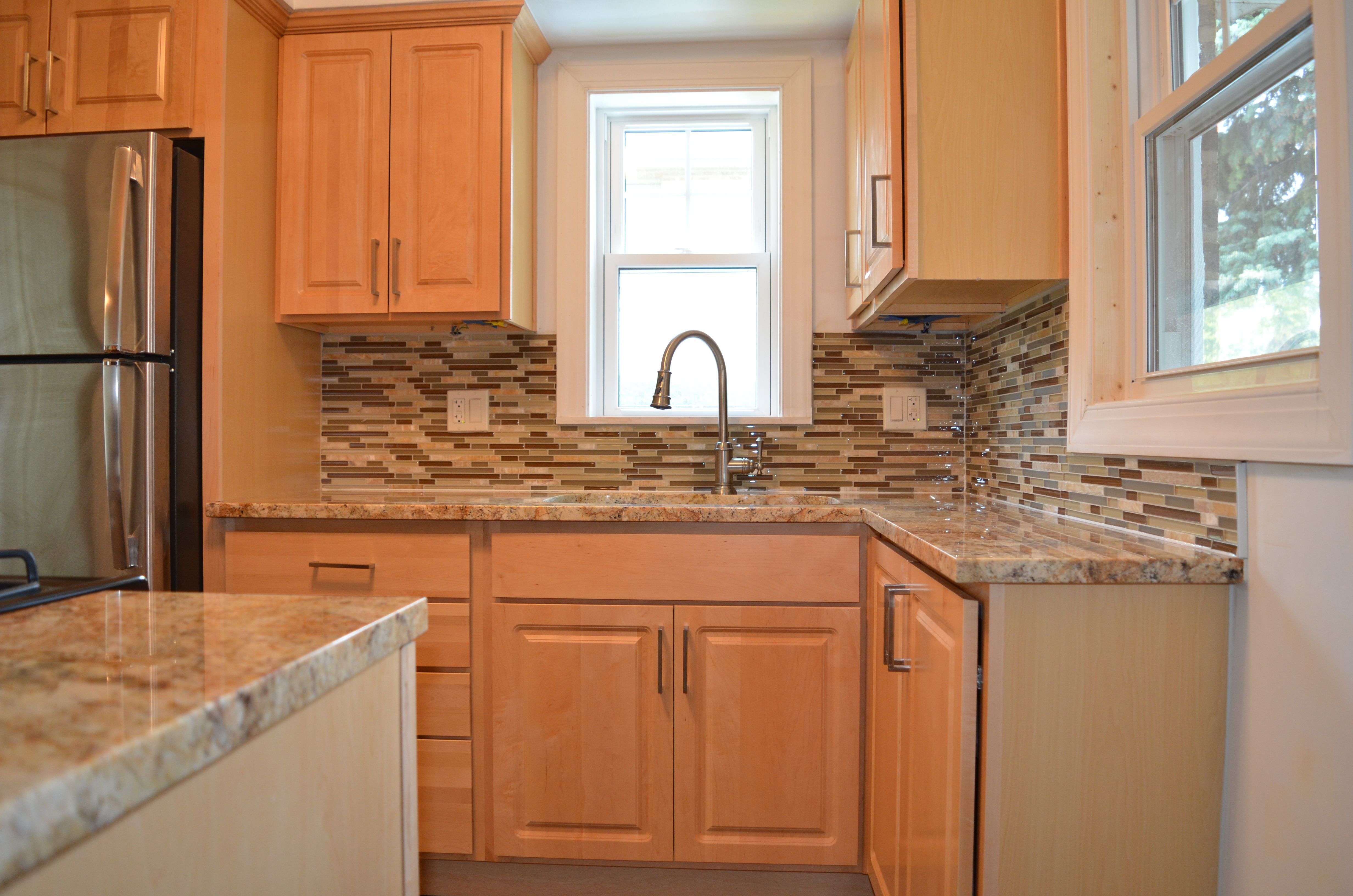 Kitchen Remodel With Natural Maple Cabinets, Granite Countertops, Glass  Tile Backsplash, Chrome Accents