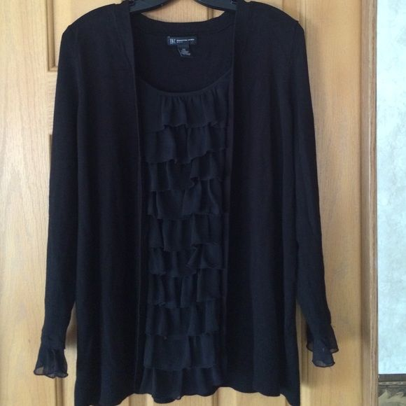 INC  ruffle front black Sweater 0X 14W INC International Concepts woman. Dressy Black sweater with ruffles at front and at end of sleeves. Size is 0X which is a woman plus size 14/16w INC International Concepts Sweaters